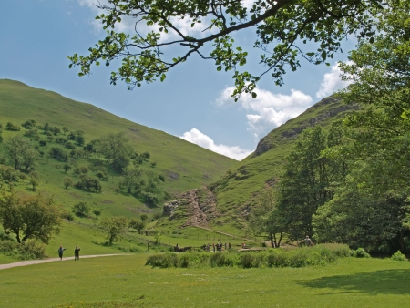 The mountains at Dovedale in Derbyshire.  Dovedale was formed by the river Dove as it cuts its way through the limestone rocks. Dovedale is part of the Peak District National Park (214 sq miles) that was created in 1951.  Stock Photo