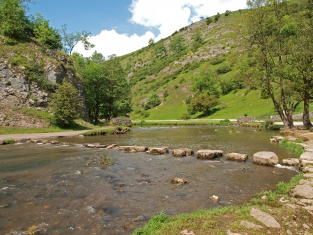 Stepping stones (placed about 1856) over the river Dove in Dovedale in Derbyshire.  Dovedale is part of the Peak District National Park (214 sq miles) that was created in 1951. It was the first National Park in Briton. photo