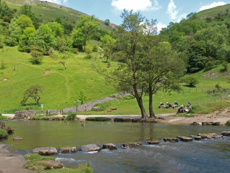 derbyshire: Stepping stones (placed about 1856) over the river Dove in Dovedale in Derbyshire.  Dovedale is part of the Peak District National Park (214 sq miles) that was created in 1951. It was the first National Park in Briton. Stock Photo