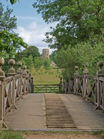 yorke: The Chinese bridge with the folly in the back ground, at the crossing point of two lakes in the grounds of Wimpole Hall. They were first started in 1697 and gradually extended until 1767 to the size and shape they are today.