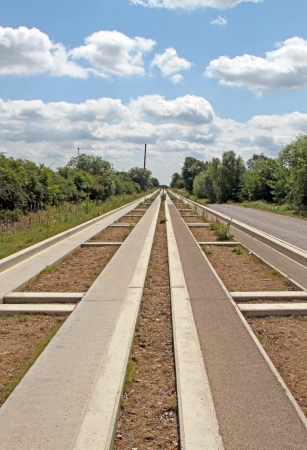 The Cambridgeshire guided bus way, linking  St Ives with Cambridge is the world's longest guided bus way. It has  been constructed along the line of a former railway. It was due to open in Spring 2009, but has been delayed by design problems. It will now  Stock Photo - 15969994