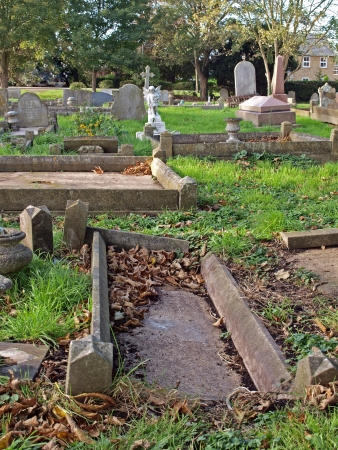 shrinkage: St Mary�s church was built level with the surrounding area . As the fens were drained adjacent land has shrunk, leaving the church standing above the cemetery.  Evidence of continuing shrinkage can be seen where grave stones have been left above ground.
