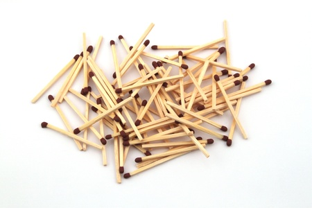 A pile of safety matches on a white background.