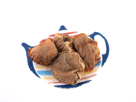 Close up of used tea bags on a white background. photo