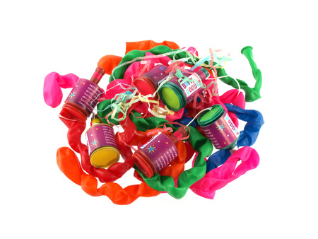 party poppers: Close up of balloons and party poppers on a white background.
