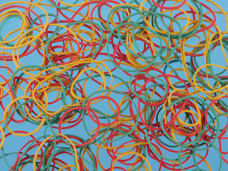 Close up of colourful rubber bands on a blue background photo