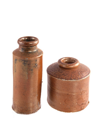 Vintage clay ink wells on a white background.  Stock Photo