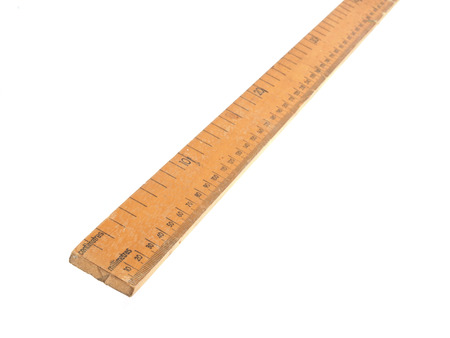 centimetres: Close up photo of a wooden meteric ruler on a white dackground