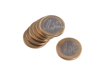 Close up photo Euro coins on a plain white background.