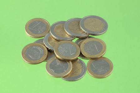 Close up photo of Euro coins on a green chromakey background Stock Photo