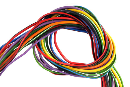 Close up photo of multicoloured wire on a white background.