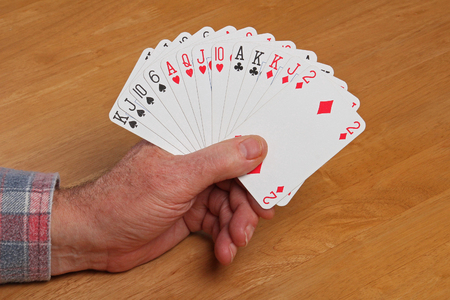 king and queen of hearts: ACOL Contract Bridge Hand. With 12 to 14 points and a balanced hand open the bidding 1NT. Stock Photo