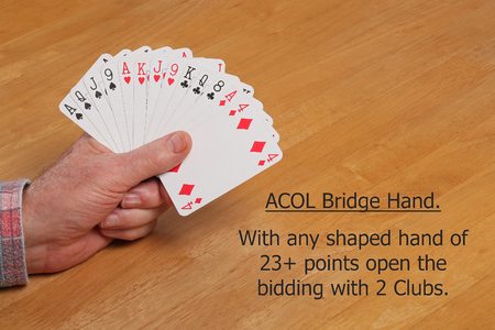 ACOL Contract Bridge Hand. With a hand of 23+ points (any shape) or 10 playing tricks open the bidding with two clubs.
