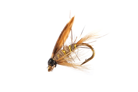 Handmade flies used by fishermen to attract trout and salmon by game fishermen. Foto de archivo