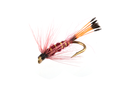 Handmade flies used by fishermen to attract trout and salmon by game fishermen. Stock Photo