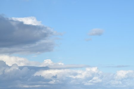 A weatherfront moving into a clear blue sky, showing a number of different cloud types.