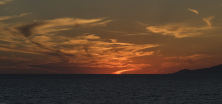 palinuro: Cilento, Palinuro, Campania sunset at sea. red sky with clouds, the line of the horizon outlined, evening, summer, landscape of southern Italy. Stock Photo