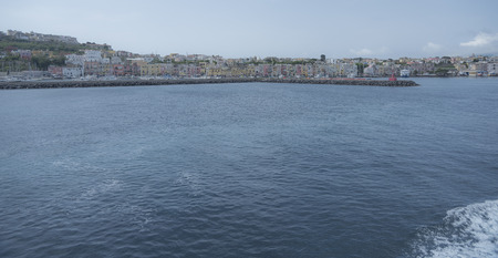 coastline: Procida Island. View of the coastline by boat. Landscape, houses and view of the harbor.