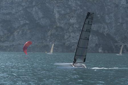 dinghies: windsurfing, skysurf, catamaran, sailing dinghies, sailing using wind Alpine Lake Garda