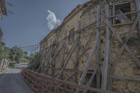 abandonment: Old Roscigno, Cilento, dangerous building. Props wood Stock Photo