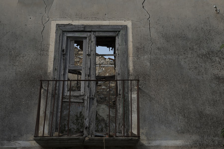 ghost rock: Old Roscigno, Cilento, dangerous building. Steel props. Window with wooden frame.