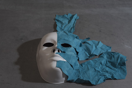 layer mask: White Mask on gray background covered with skin Stock Photo