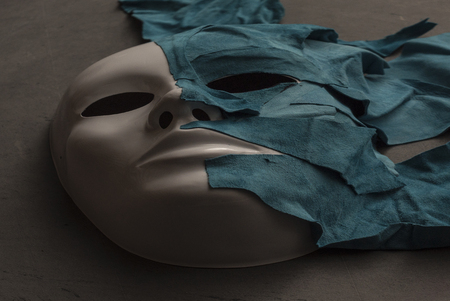 layer masks: White Mask on gray background covered with skin Stock Photo