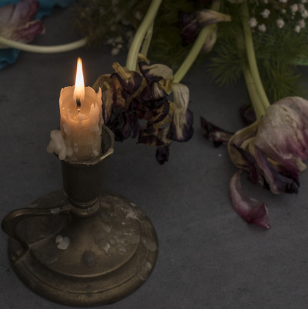 layer mask: candle and tulips dry on the blackboard