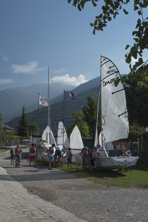 pratice: Torbole, Italy, 2015 August 3. Sails,boats, surfing, Groups of people coming out to pratice and learn the use of boats.