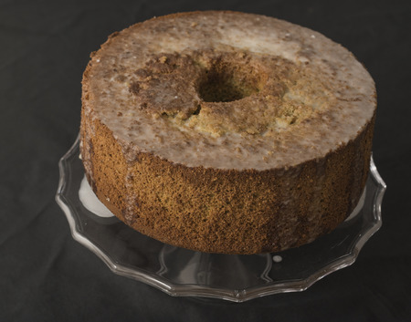 backsplash: chiffon cake , donuts, wheel, green tint and the smell of spices, on the glass tray. white background