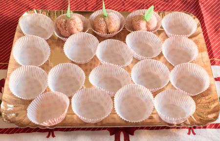 liqueurs: Tray of sweet Italian food. Peache liqueur with soul of lemon cream and sugar.