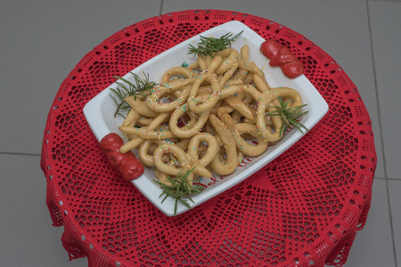 Scavuratielli, Christmas sweets of italian tradition. Cilento food. Fried donuts covered in honey