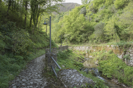 obelisk stone: Pathe along the stream, in the countryside leading into the mountain.