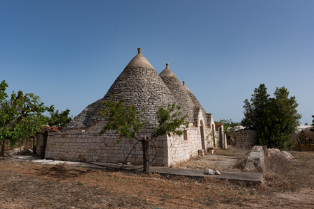 Trullo, Puglia. Italy. Stone houses. Murgia. Details of the land and the walls.