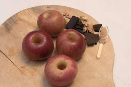 Four Italian Apples, Chocolates, Walnuts and Cinnamon. Recipe to prepare a sweet. Whole Preparation. Stock Photo