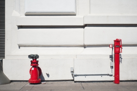 Red fire hydrants with white background in San Francisco Stock Photo