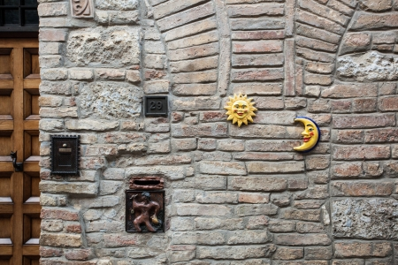 Door knocker and charms in Italian street