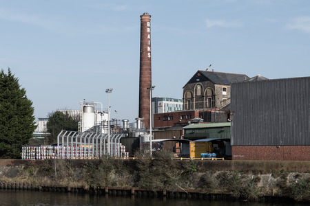samuel: Cardiff, Wales, UK - February 13 2017: Brains Brewery next to the River Taff. Regional brewery factory adjacent to Cardiff Central Railway Station, operated by S.A. Brain & Co. Ltd. Since 2000 Editorial