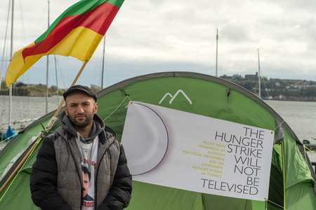 CARDIFF, UK - APRIL 14 2017 Imam Sis conducting hunger strike outside Senedd. Protest by Kurdish Solidarity Wales in support of polital prisoners jailed in Turkey, held outside National Assembly of Wales