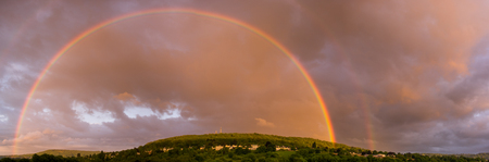 Double rainbow over Bathampton. Panorama of countryside on outskirts of Bath, UK, following heavy May showers