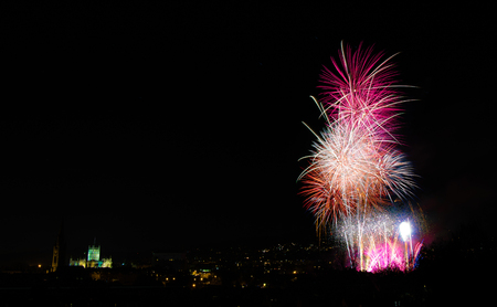 Fireworks over Bath, with Abbey. A composite image of fireworks being let off to celebrate bonfire night in Bath, England, UK
