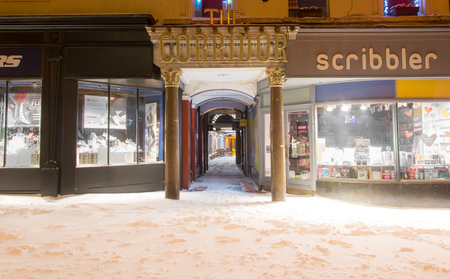 BATH, UK - MARCH 01 2018 The Corridor in Bath, in the snow at night. Shopping arcade in UNESCO World Heritage city