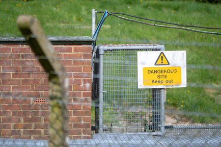 Dangerous Site Keep Out sign. Warning at industrial facility