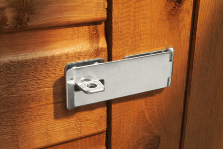 hasp: Closed hasp on shed door without padlock