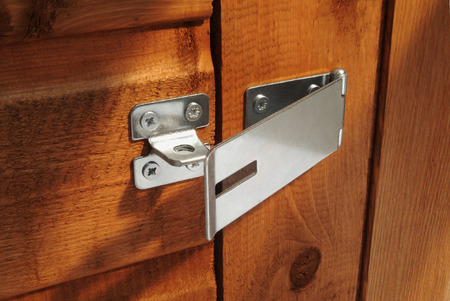 hasp: Open hasp on shed door without padlock Stock Photo