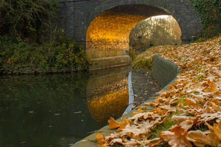 Arch of a bridge over the river thames at St Johns Lock, Lechlade on winters morning