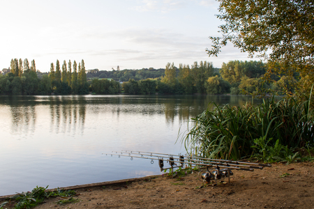 Carp Angling scenic landscape overlooking lake at Dawn Stock Photo