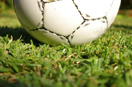 Soccer ball macro on green grass