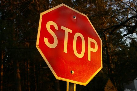 stop sign at dusk Stock Photo