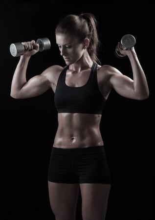 dumb: Female exercising with dumb bells Stock Photo